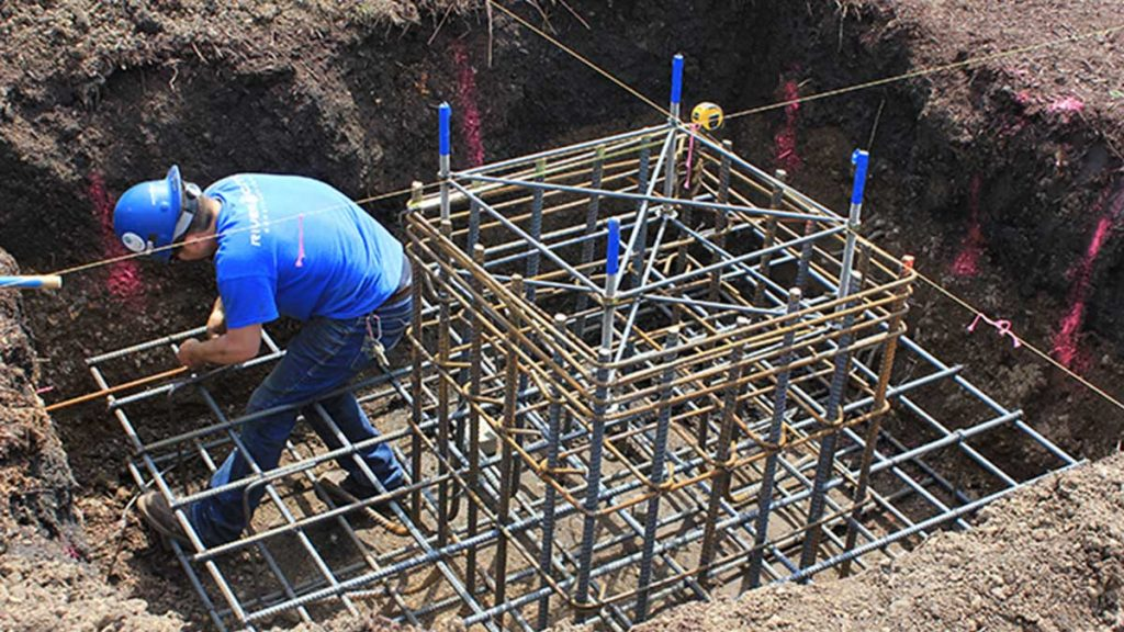 Mason Construction Worker Tying Rebar