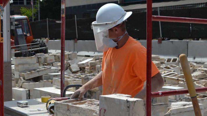 Building Construction Worker Cutting Concrete